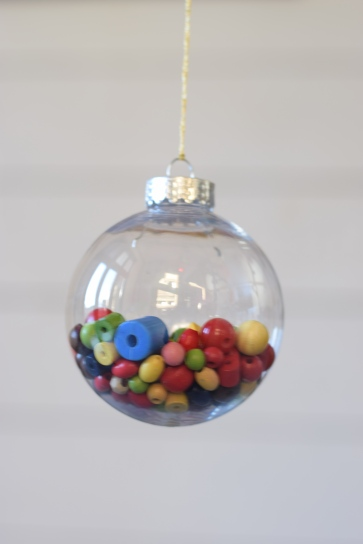 Christmas bauble filled with beads