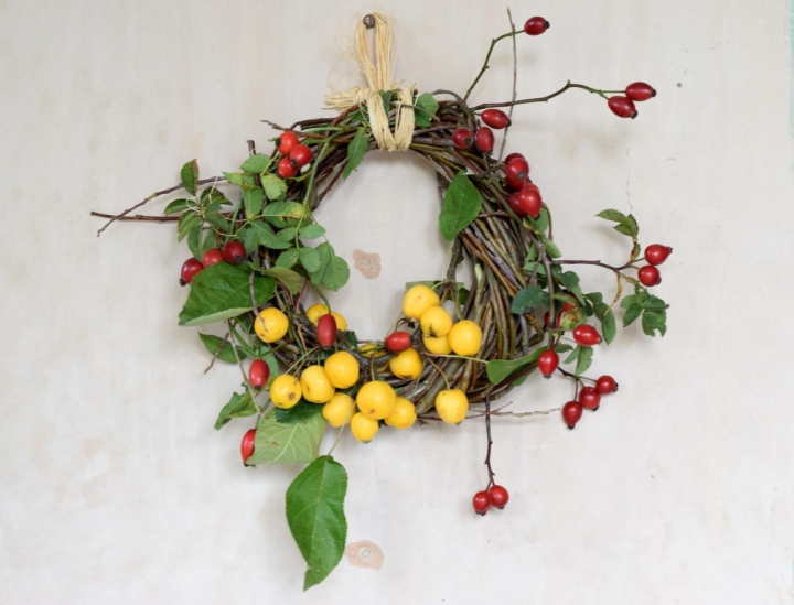 autumn wreath with rosehips and crab apples