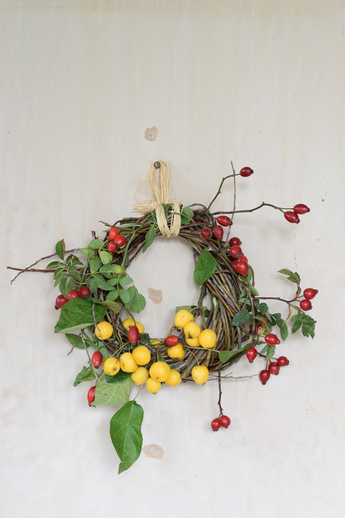 autumn wreath of willow with crab apples and rosehips