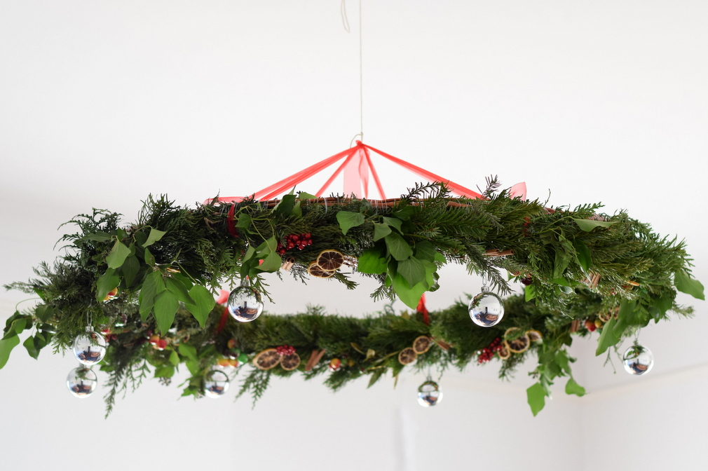 Giant Christmas wreath hanging from ceiling