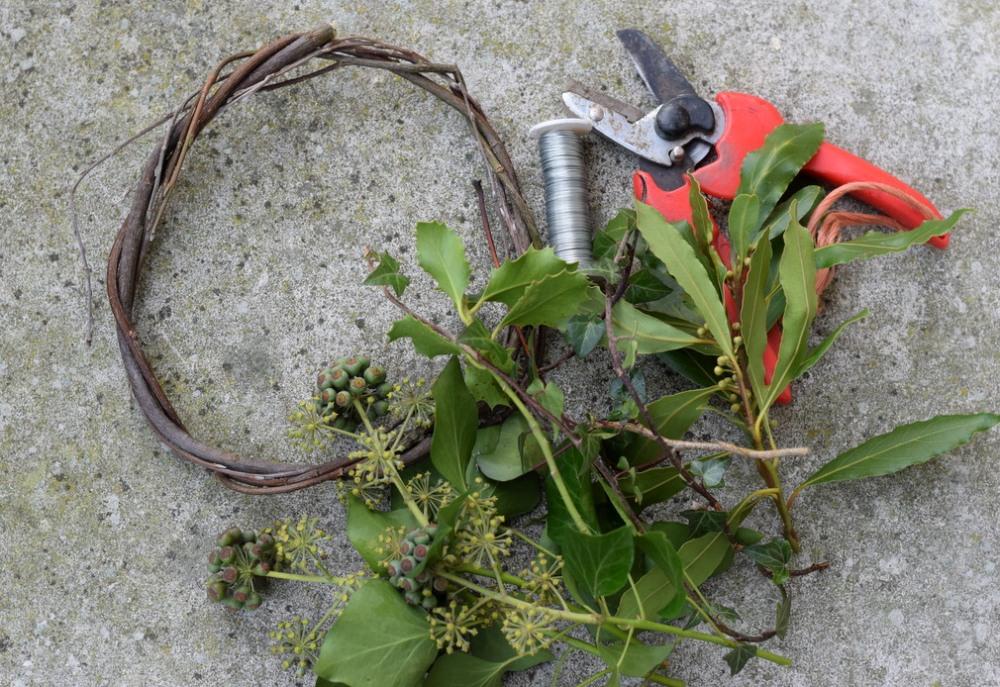 making Christmas wreath with fresh foliage
