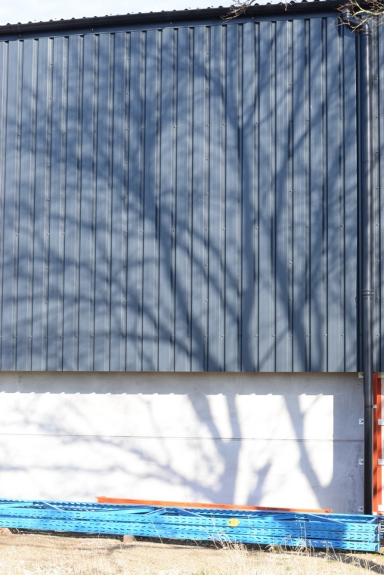 Tree shadow on farm barn