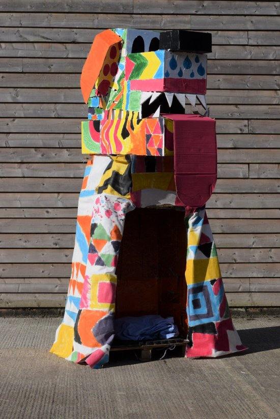 Giant dog made from recycled cardboard, fabric and wooden pallet