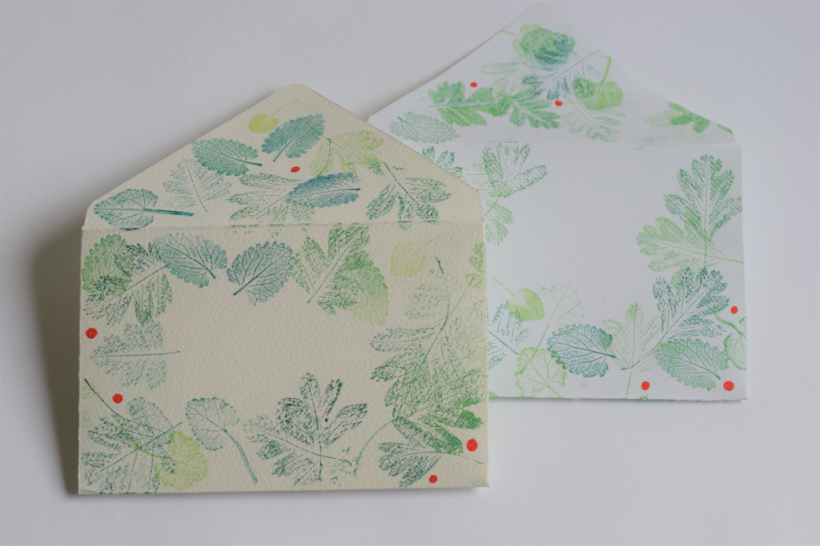Hand made envelopes decorated with hand printed nature prints using jelly plate