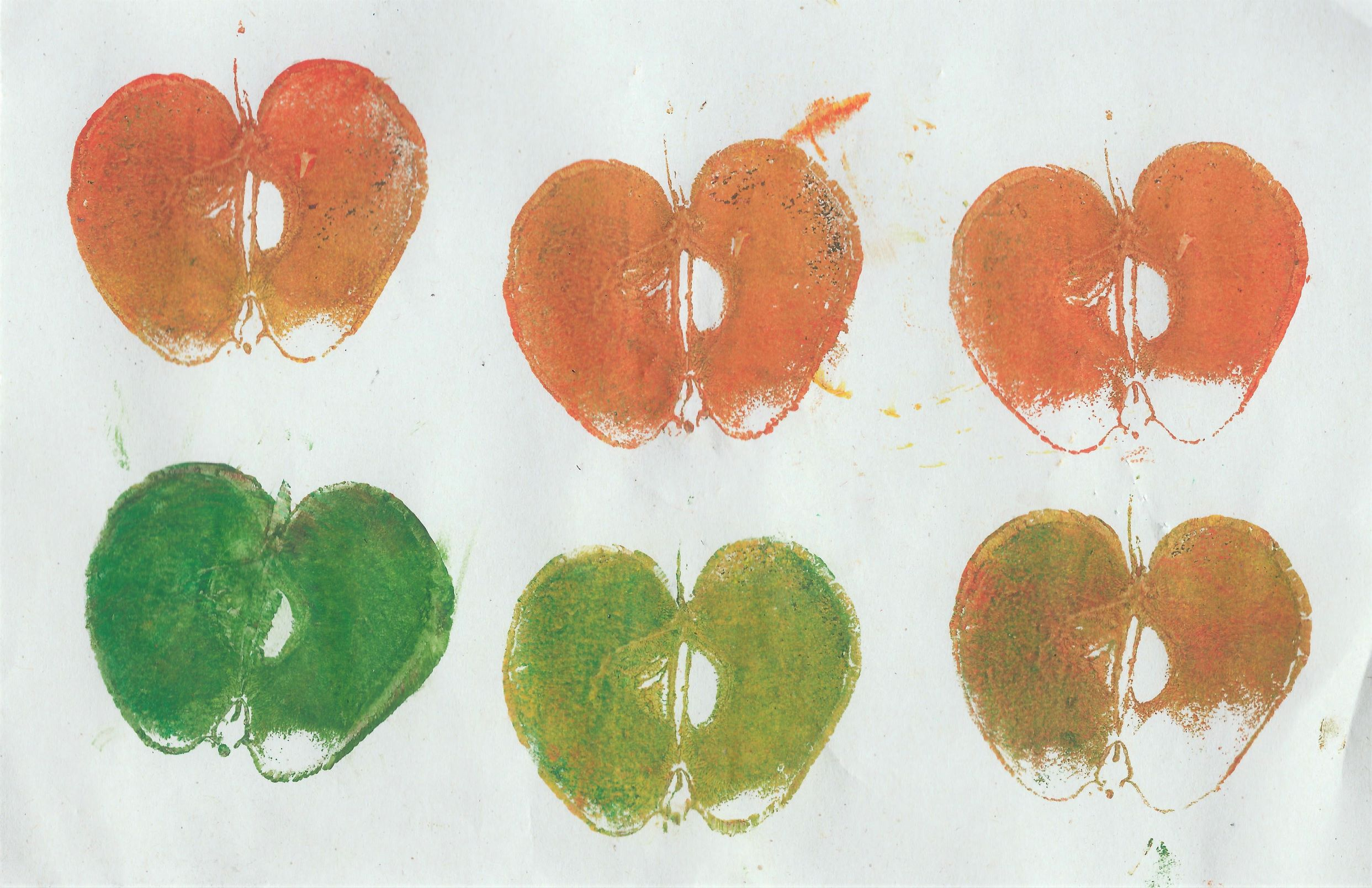 Printing with apples by small child