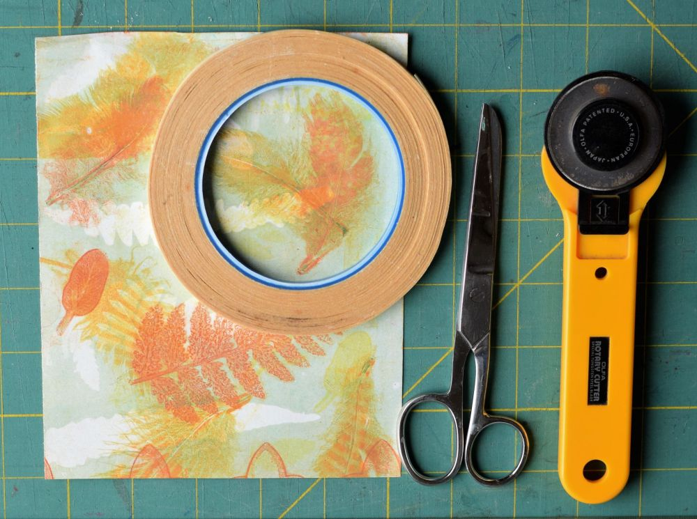 Paper, double sided sticky tape, scissors, cutter for making decorative tapee