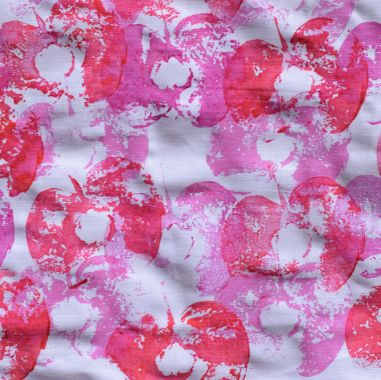 fabric printed with apples using red and pink ink