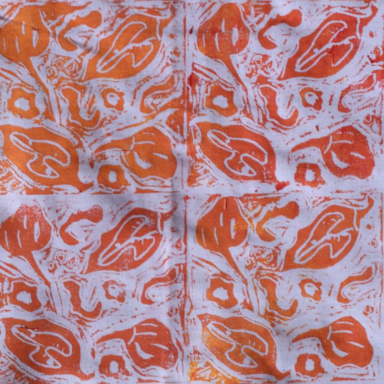 fabric printed with lino block and orange ink