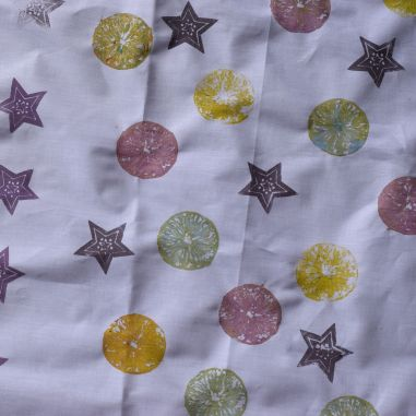 fabric printed with fruit and stamps