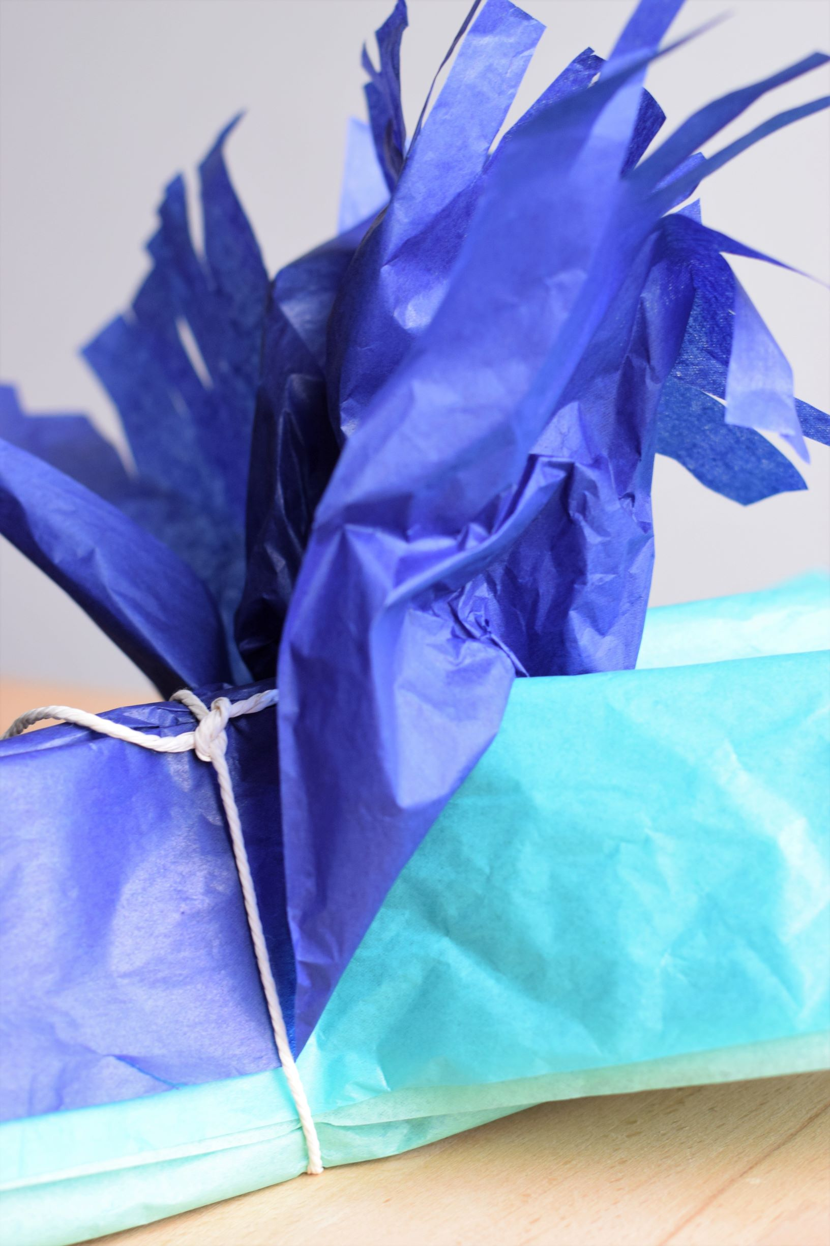 Making pom poms with tissue paper