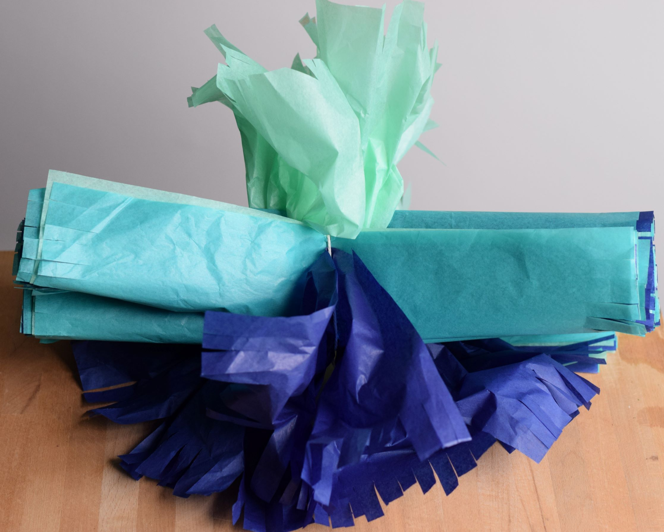 Making tissue paper pom poms first layers