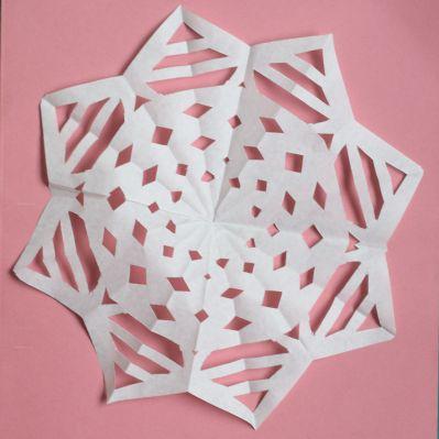 Making flat paper snowflake step 6