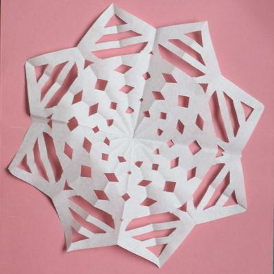Making flat paper snowflake step 6