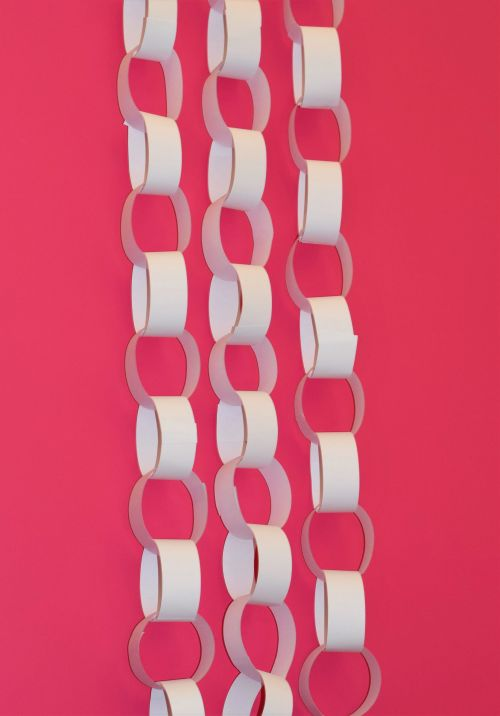Christmas paper chains hanging vertically