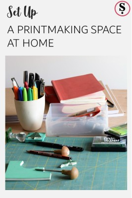 A printing space at home with lino tools and rubber stamps