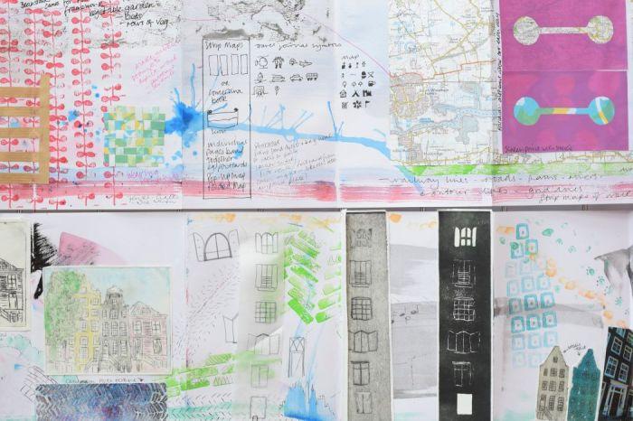 Sketchbooks depicting printing in progress on theme lines