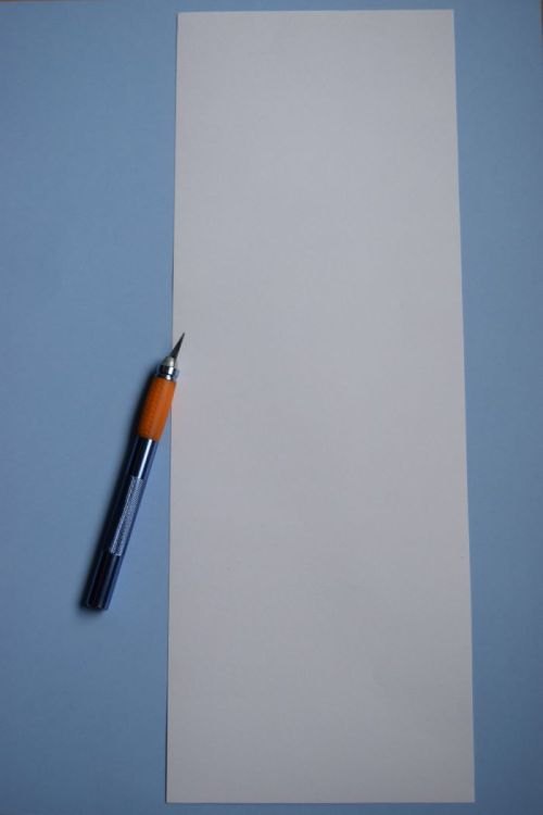 sheet of paper and craft knife