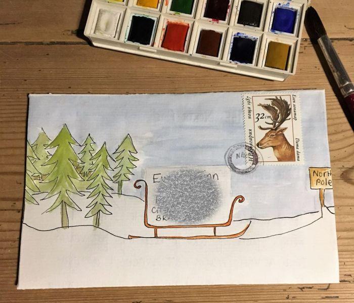 Mail Art envelope trees, snow , sleigh and reindeer stamp