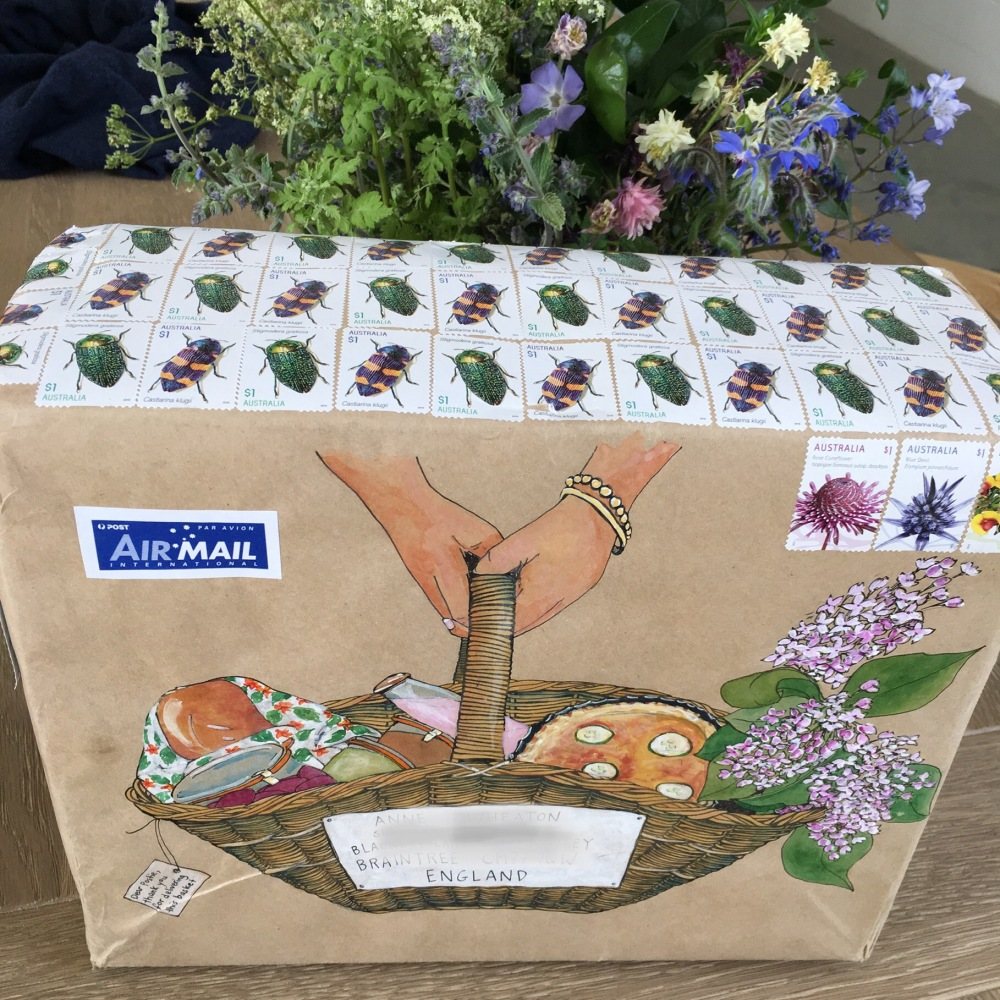 Parcel with mail art and bunch of flowers