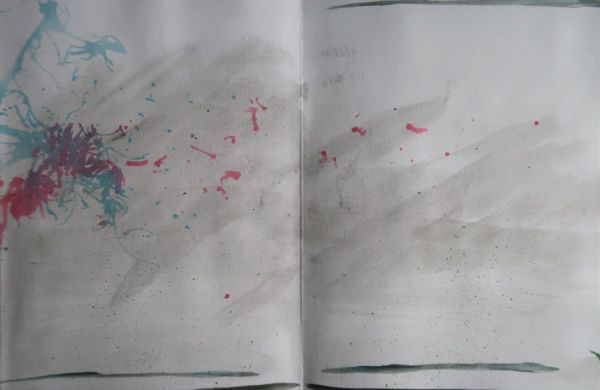 paint spatters and wash in sketchbook