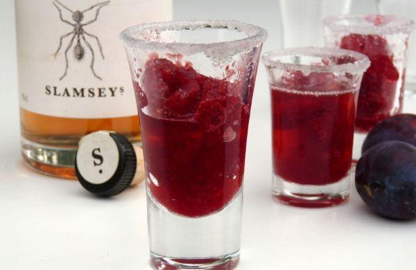 iced plum gin in shot glasses with bottle Slamseys Plum gin