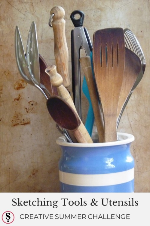 jar filled with kitchen implements
