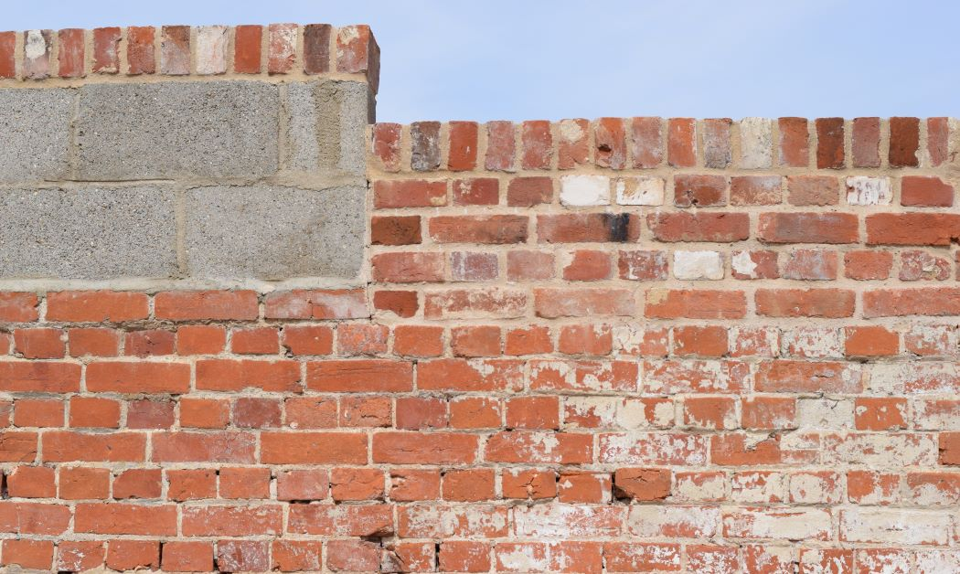brick and block wall with sky above