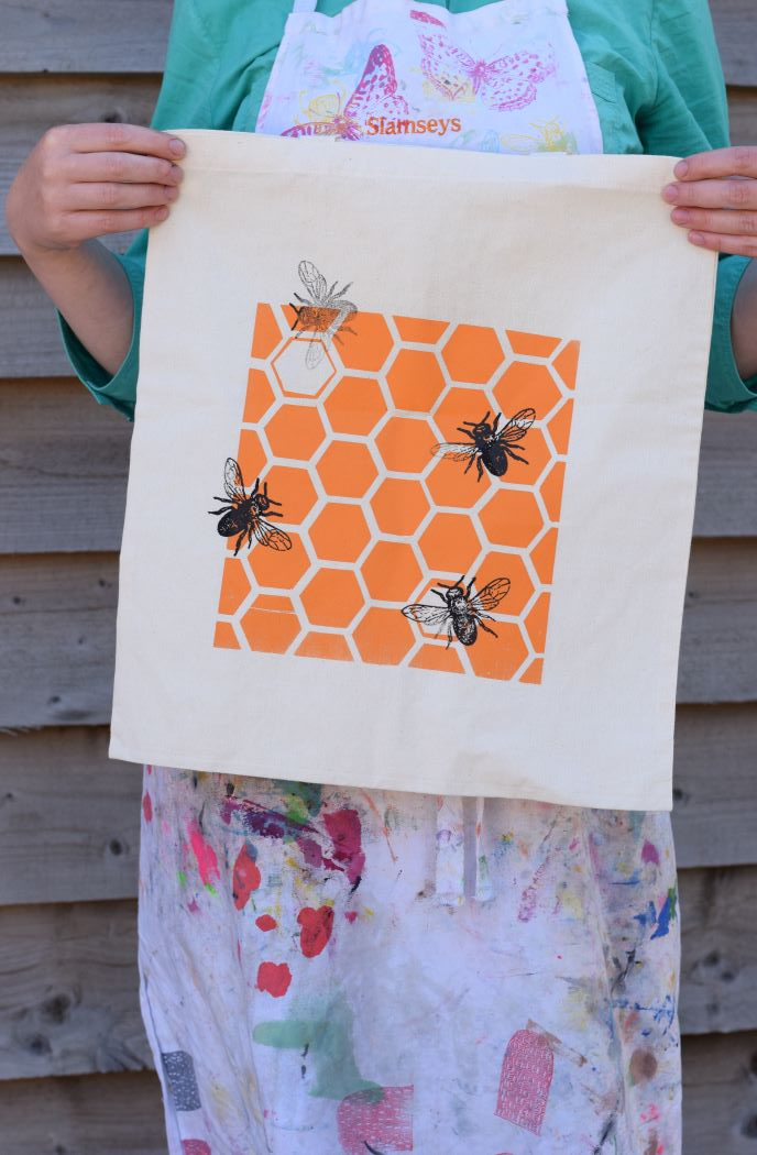 screenprint of bees and honeycomb on fabric bag