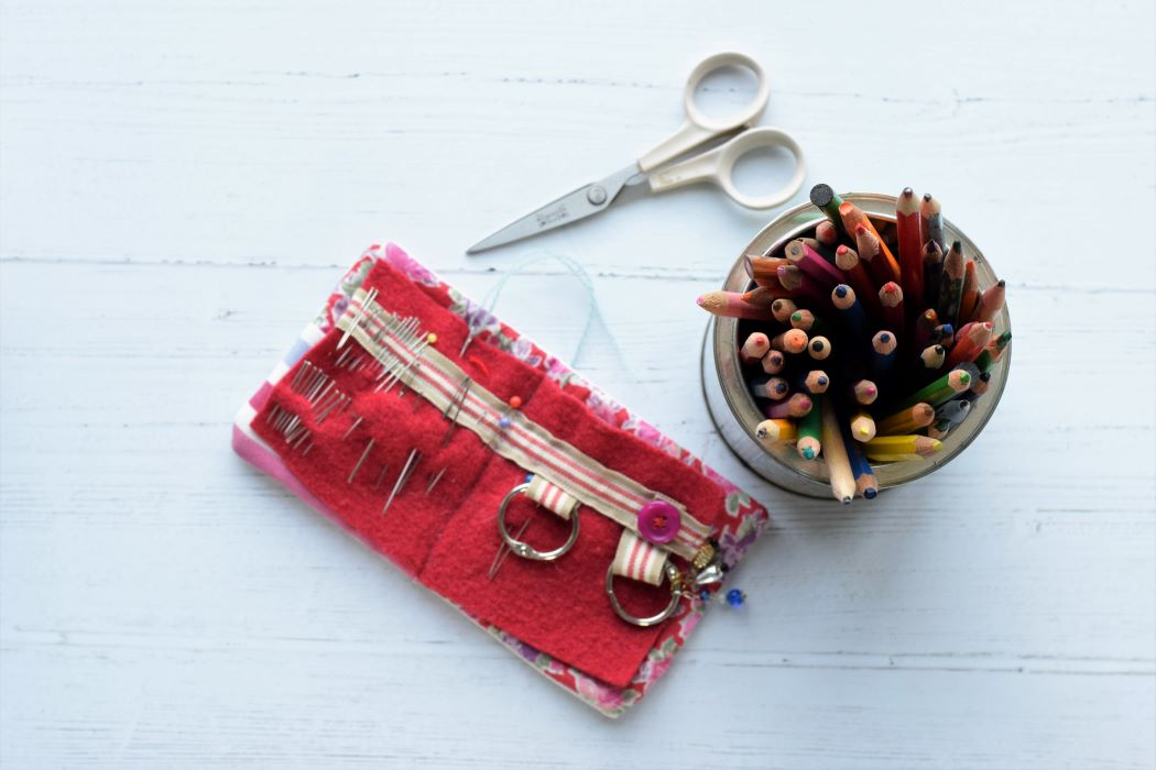 scissors needle case and pencils