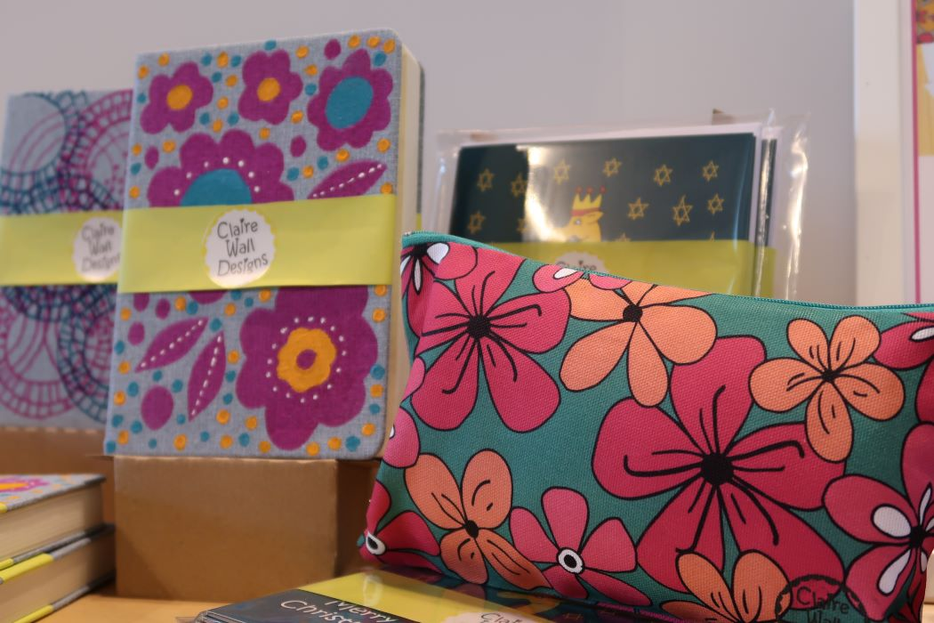 Printed book covers, Christmas cards and fabric bag by Claire Wall Designs