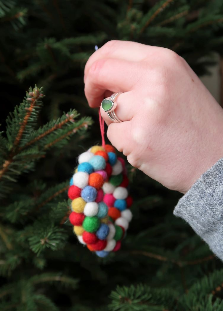 hanging Christmas decoration on Christmas tree