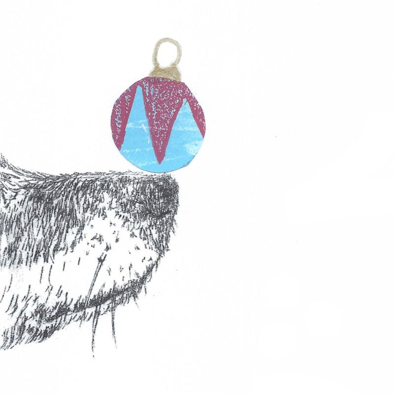 Drypoint of dog's nose with collaged bauble balancing on the end