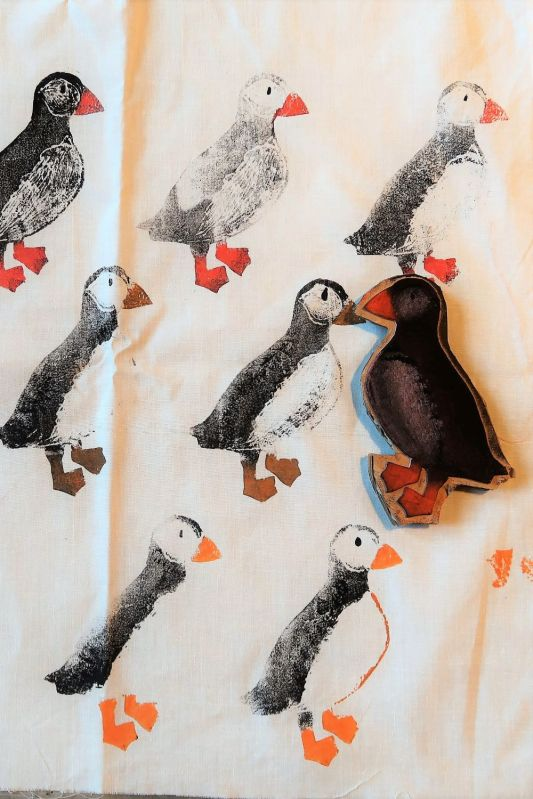 fabric printed with puffins with block