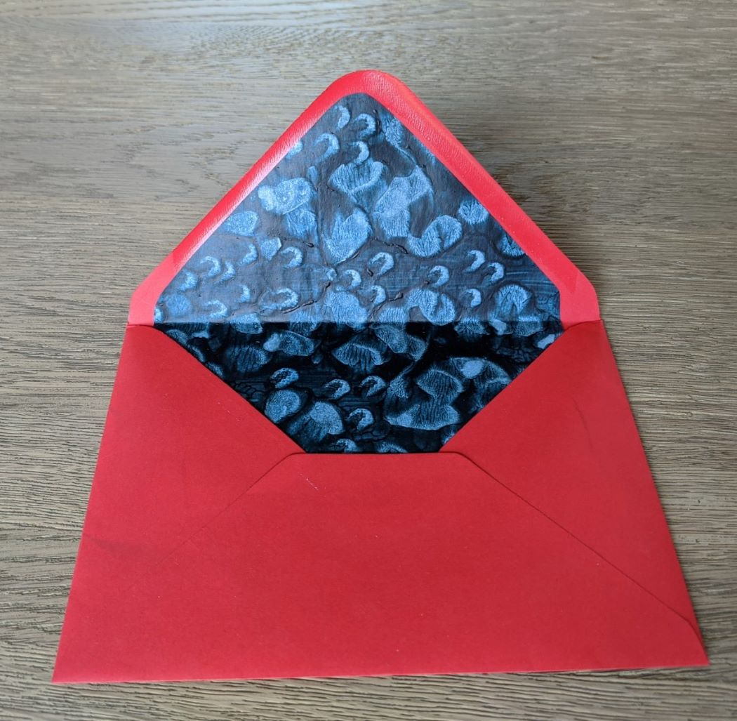 Red envelope with dark blue paste paper lining