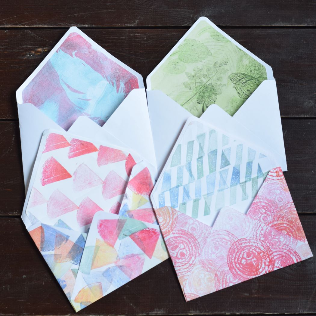 Four hand decorated envelopes with hand printed lining paper