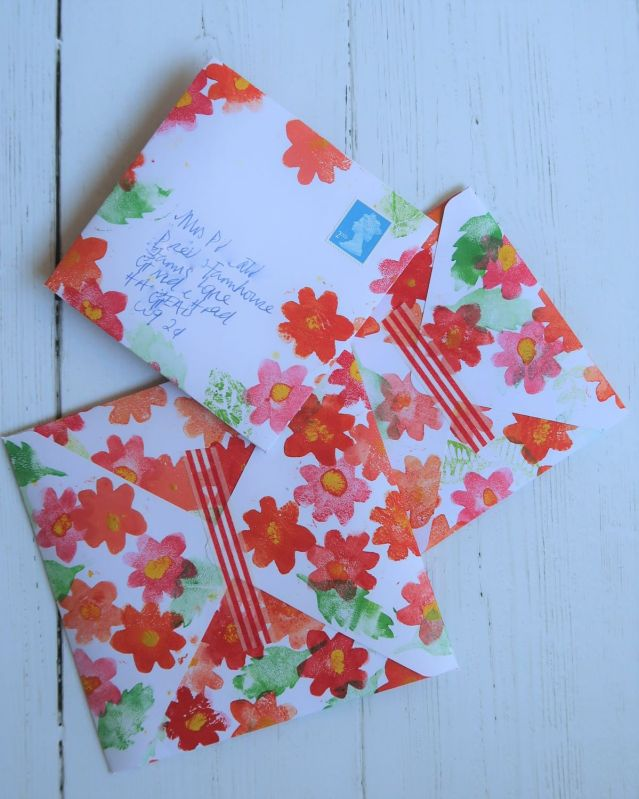 Hand made envelopes printed with foam block flower shapes.