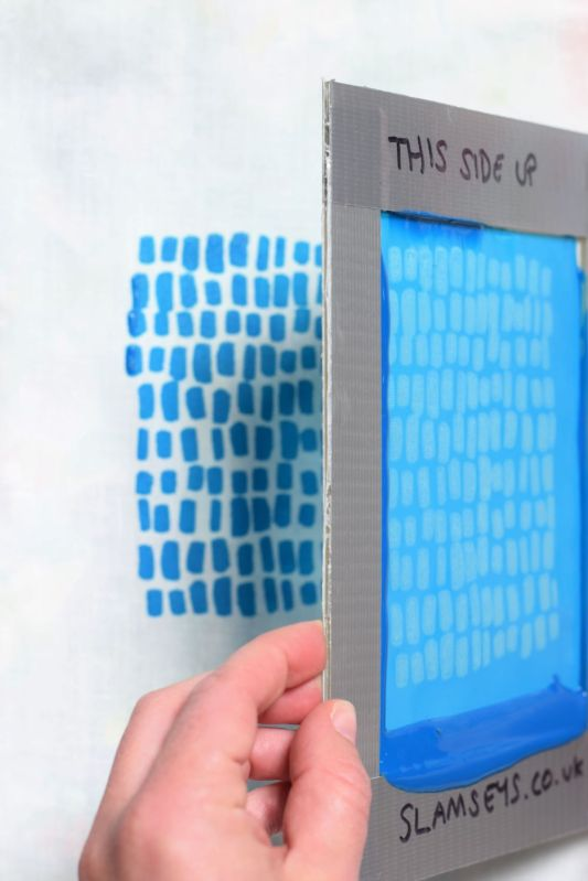 Lifting a Mini Screen to reveal the screen print