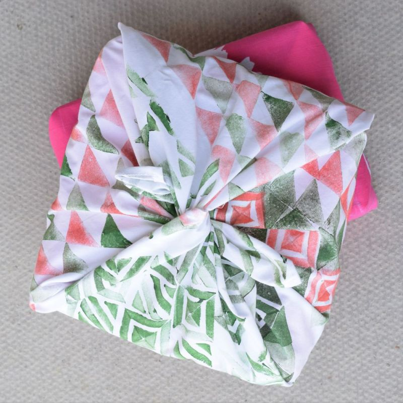 Gift wrapping made from fabric can be used time and time again unlike conventional wrapping that's tossed in the bin after one use. Make your own with fabric that you print yourself.