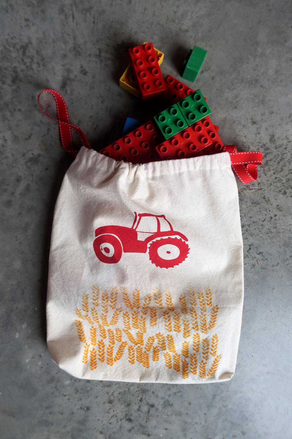 Screen printed tractor and wheat field on hand made drawstring bag