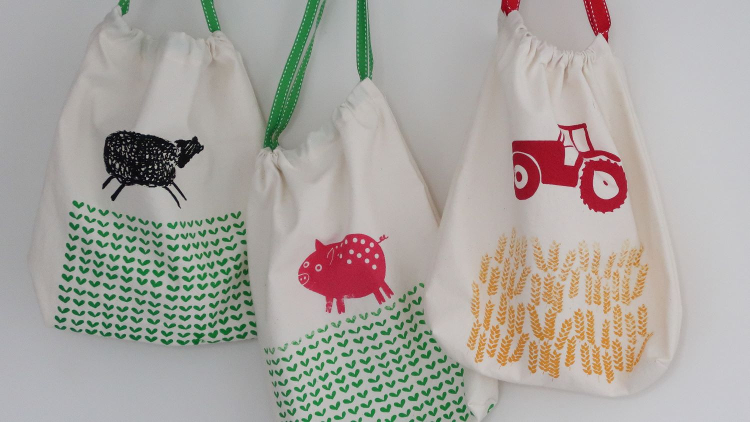 3 screen printed drawstring bags with sheep, pig and tractor