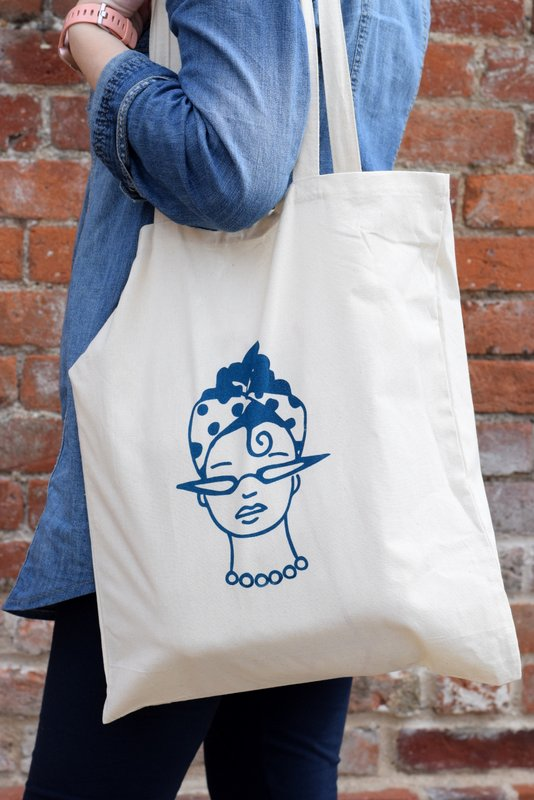 Person holding a screen printed tote bag